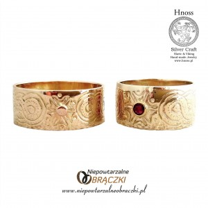 Gold Wedding Rings with Viking Ornaments and Garnet